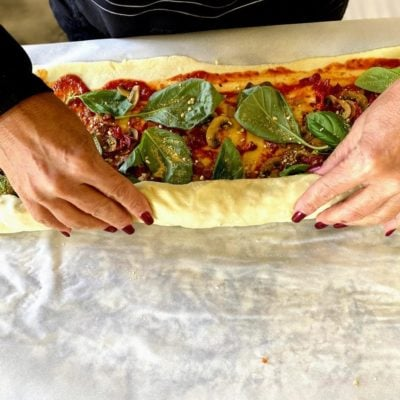 rolling the pizza pinwheels